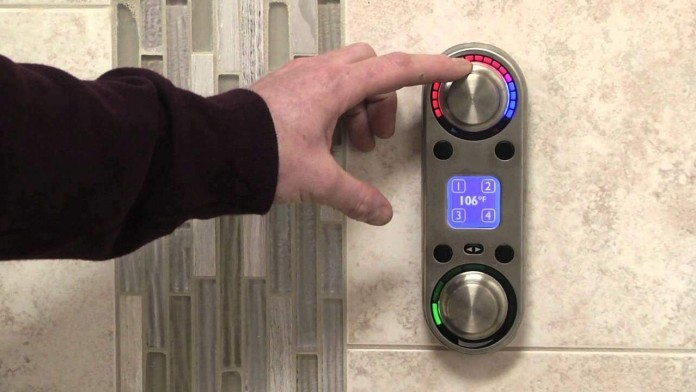 A-digital-shower-control-in-use-future-of-bathroom-technology