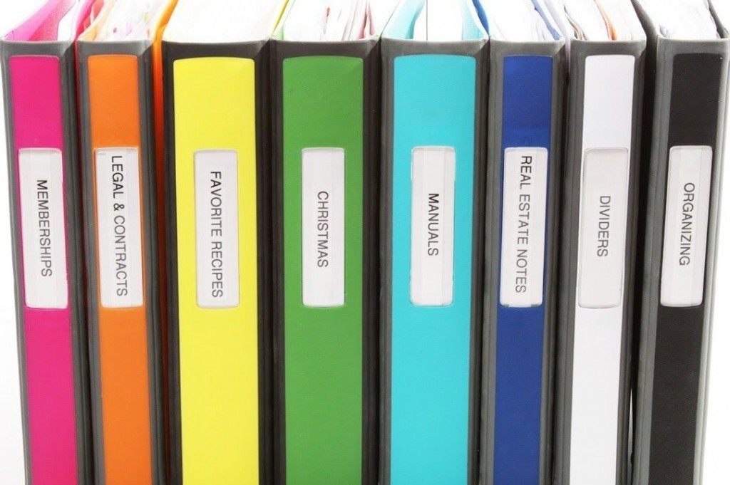 assortment-of-personally-labeled-binders-organizing-your-office-workspace