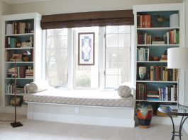 Bookcases-next-to-window-seat.-nice-reading-room-living-space-reading-nook