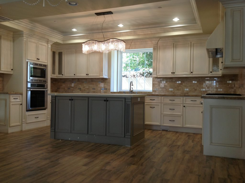 antique-white-cabinets-with-gray-island